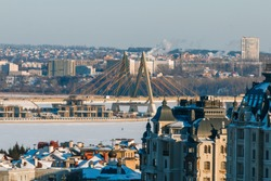 Modern and classic buildings in the urban landscape in the winter
