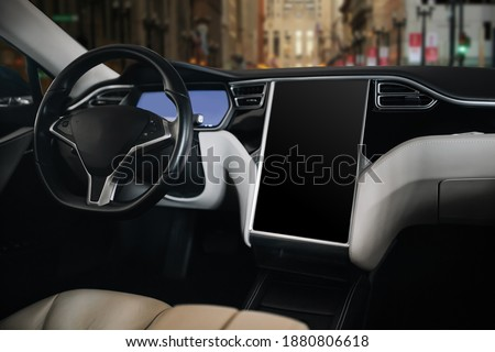 Modern and futuristic car steering wheel and futuristic monitor