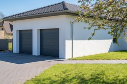 Modern and luxurious double garage with driveway and roller door