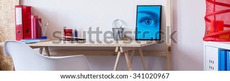 Modern and minimalist desk in a boy\'s room