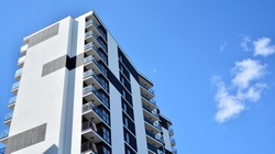 Modern and new apartment building. Multistoried modern, new and stylish living block of flats.