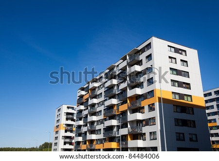 Modern and new apartment building. Multistoried modern, new and stylish living block of flats. Real estate. New house.Newly built block of flats