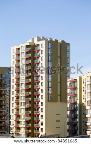 Modern and new apartment building. Multistoried modern, new and stylish living block of flats. Real estate. New house.Newly built block of flats.