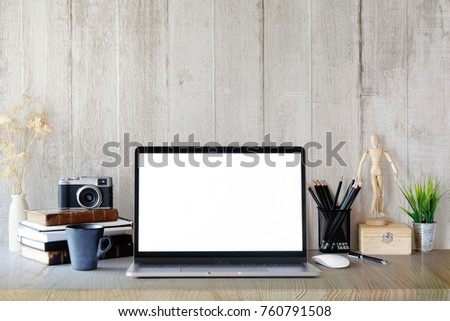 Modern And Stylish Workspace With Laptop Computer, Office Supplies, Books,  Retro Camera At