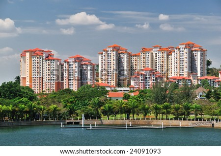 Modern Apartment Block Houses and Garden with Lake