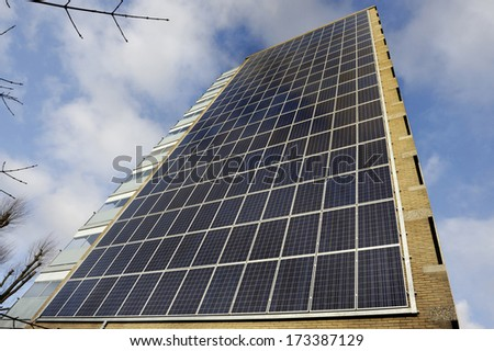 Modern apartment building with solar panels