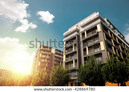 Modern apartment buildings exteriors in sunny day