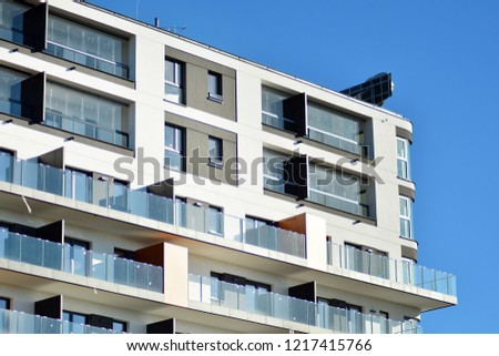 Modern apartment buildings on a sunny day with a blue sky. Facade of a modern apartment building.