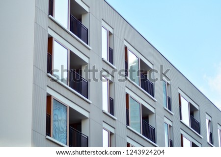Modern apartment buildings on a sunny day with a blue sky. Facade of a modern apartment building #1243924204