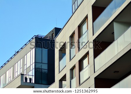 Modern apartment buildings on a sunny day with a blue sky. Facade of a modern apartment building #1251362995