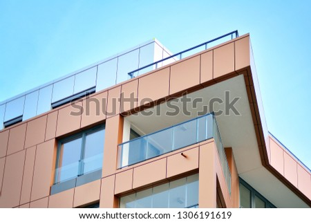 Modern apartment buildings on a sunny day with a blue sky. Facade of a modern apartment building #1306191619