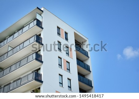 Modern apartment buildings on a sunny day with a blue sky. Facade of a modern apartment building #1495418417
