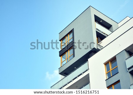 Modern apartment buildings on a sunny day with a blue sky. Facade of a modern apartment building #1516216751