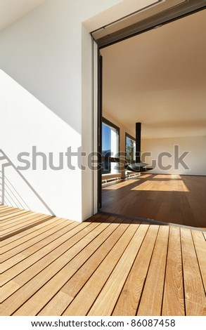 Modern apartment, entrance from the balcony, overlooking the living room