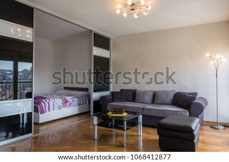 Modern apartment interior with living room and bedroom #1068412877