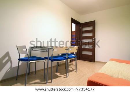 Modern apartment interior with orange sofa - stock photo