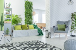 Modern apartment with 3d wallpaper, sofa, armchair and pouf