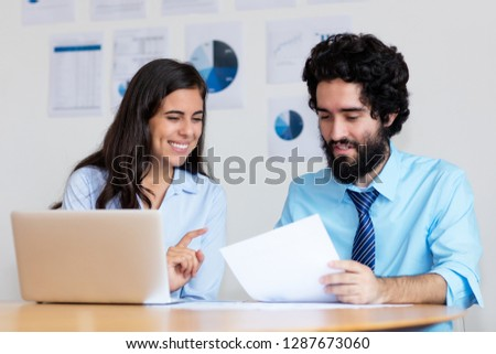 Modern arabic business team at work at desk at office of company