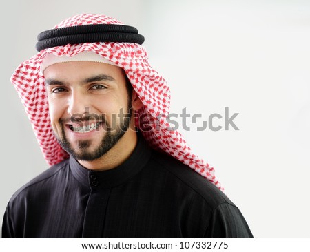 Modern Arabic businessman showing clean and healthy teeth