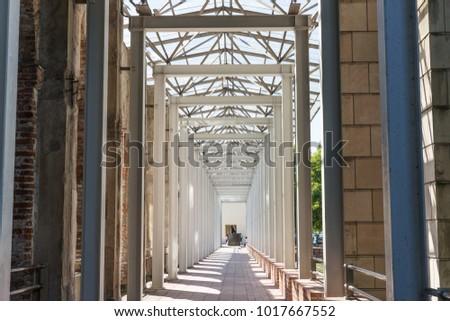 Modern arcade with vertical high metal columns