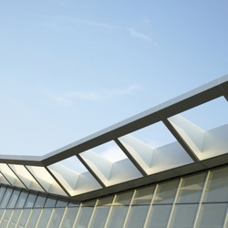 Modern architectural building awning against blue sky