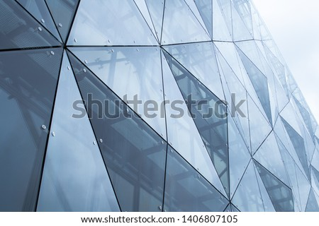 Modern architectural details. Modern glass facade with a geometric pattern