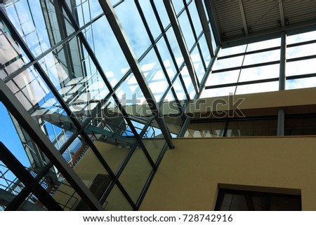Modern architectural elements with reflections and blue sky #728742916