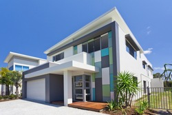 Modern architectural house exterior with blue sky