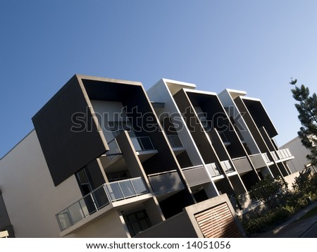 Modern architecturally designed apartment block on an angle