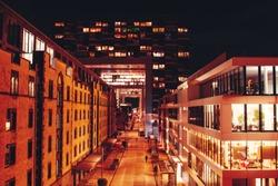 Modern architecture buildings office Crane House (Kranhaus) at the harbour Rheinauhafen at night blue hour. German city Köln, Cologne in Germany