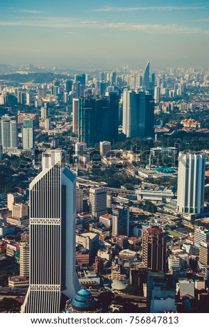 Modern architecture, business office building, cityscape background. Kuala Lumpur skyline. Travel to Malaysia. Urban skyscrapers. Modern city. Financial district. Aerial view of downtown. Vertical