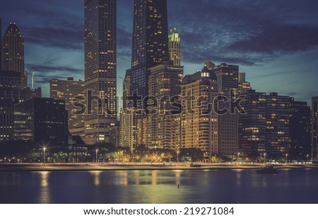 Modern architecture by dusk with reflections in the water