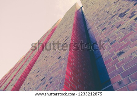 Modern architecture - clinker brick walls with niche in the morning light