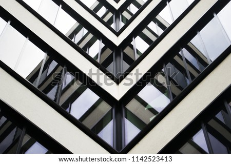 Modern architecture details. Metallic white facade. Business office.
