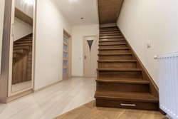 Modern architecture interior with elegant luxury hallway with glossy wooden staps stairs in modern storey house