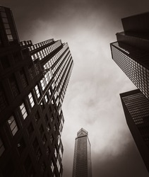 Modern architecture of Manhattan on an overcast day. Old photo stylization, film grain added. Sepia toned
