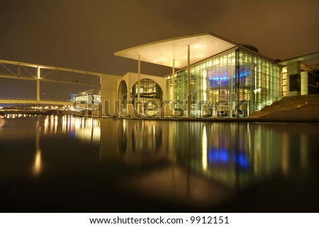 modern architecture reflecting in water