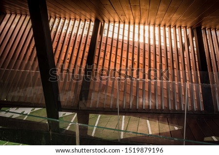 Modern architecture with metal, glass and wood. The building is reflected by the morning sun. Beauty from the inside of the building #1519879196