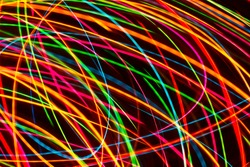 Modern art background. Long exposure neon lights texture. Colorful glow lines backdrop for graphic design. Illuminated mesh pattern.