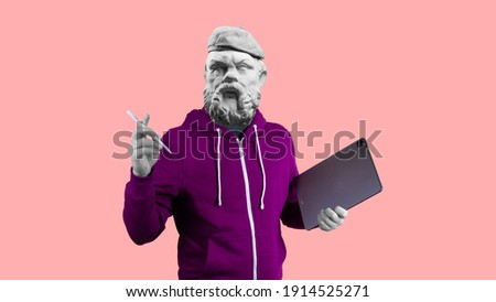 Modern art collage. Concept portrait man holding tablet and pencil. Gypsum head of Socrates.