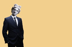 Modern art collage. Concept portrait of a  businessman pointing finger .Gypsum head of of Apollo. Man in suit.