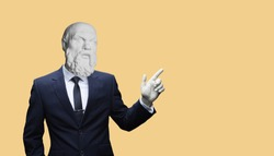 Modern art collage. Concept portrait of a  businessman pointing finger .Gypsum head of of Socrates. Man in suit.