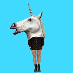Modern art collage. Concept Womans body with Unicorn head.