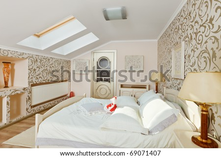 Modern art deco style bedroom interior in light beige colors on loft room