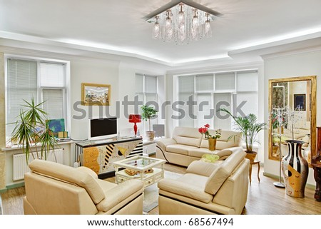 Modern art deco style drawing-room interior with beige leather furniture and TV