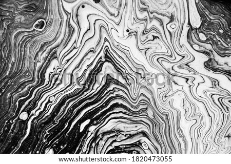 Modern art. Minimalist trendy background hand painted with acrylic paints poured to canvas creating curves, swirls and rings. Triangle form. Black and white.   Stock photo ©