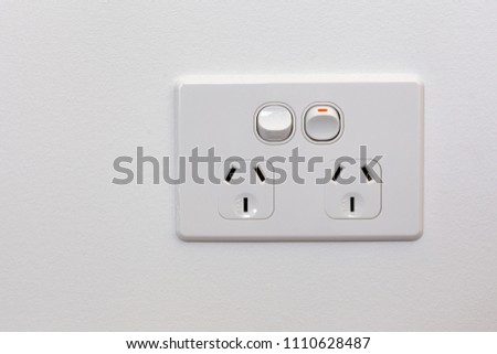 Modern Australia double power outlet on white wall