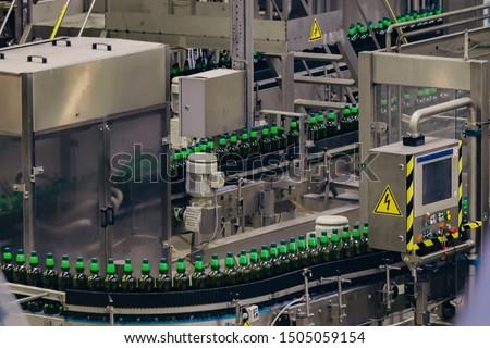 Modern automated beer bottling production line.