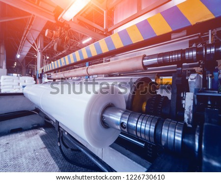 Modern automated production line in factory. Plastic bag manufacturing process. Background