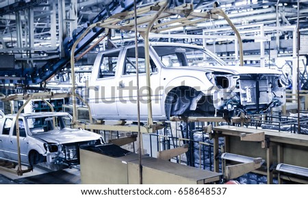 Modern automatic automobile manufacturing workshop. A busy car production line. Industrial scenery background.